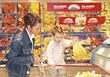 Mom and Toddler Food Shopping stock photography