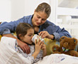 Mom Taking Care of Sick Daughter stock image