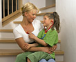 Mom with Daughter Playing Doctor stock image