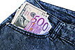 Money In Blue Jeans Pocket On White Background.