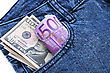 Money In Blue Jeans Pocket On White Background. stock photography