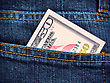 Money In The Pocket Of Blue Jeans stock photo