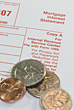 Mortgage Interest Statement Tax Form 1098 & Coins stock image