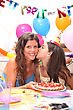 Mother And Daughter At A Birthdayparty stock photography