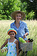 Mother And Daughter Carrying Baskets stock photo