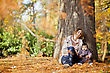 Mother and daughter in the autumn forest stock photography