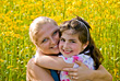 Mother and Daughter in a Flower Field stock image