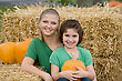 Mother and Daughter in a Pumpkin Setting stock photo