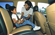 Mother Buckling Up Child stock image