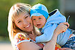 Mother Cuddling Young Son, Outdoor Portraits