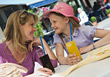 Mother & Daughter Drinking Soda stock photography