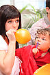 Mother Inflating Party Balloon stock photo