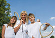 Mother & Kids Playing Tennis stock photo