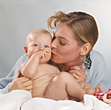 Mother Kissing Baby stock photography