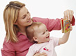 Mother Reading to Baby stock photography
