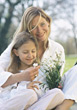 Allergic Mother with Daughter Smelling Flowers stock photo