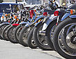 Rims Motorcycles in a line parked on a street stock image