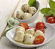 Mozzarella Cheese With Olive Oil ,Herbs , Spices And Tomatoes