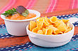 Nachos And Cheese Sauce On Colorful Towels stock image