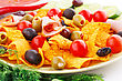 Nachos, Olives, Pork Loin And Vegetables Image stock photo