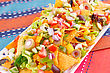 Nachos And Vegetables On Plate On Colorful Towels