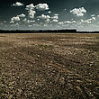 Natural Disaster. Abstract Landscape With Dry Land Under Mood Skies stock photography
