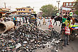 NEW DELHI, INDIA - APRIL 10: Big Garbage Heap And Unidentified People On The Street On March 27, 2012, New Delhi, India. India Is A Very Dirty Country stock photo