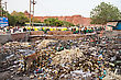 Environmental NEW DELHI, INDIA - APRIL 10: Big Garbage Heap And Unidentified People On The Street On March 27, 2012, New Delhi, India. India Is A Very Dirty Country stock image