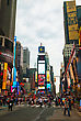 "NEW YORK CITY - MAY 11: Times Square With Tourists On May 11, 2013. Iconified As ""The Crossroads Of The World"" It's The Brightly Illuminated Hub Of The Broadway Theater District, One Of The World's Bu"