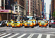 NEW YORK CITY - MAY 11: Yellow Taxis At The Street On May 11, 2013 In New York. Yellow Cars Serve As Taxis In NYC And Are Easy To Spot Among Other Vehicles Because Of Their Color