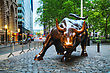 "NEW YORK CITY - MAY 12: Charging Bull Sculpture On May 12, 2013 In New York City. The Sculpture Is Both A Popular Tourist Destination Which Draws Thousands Of People A Day, As Well As ""one Of The Most stock image"