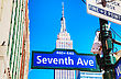 NEW YORK CITY - MAY 12: Seventh Avenue Sign And Empire State Building On May 12, 2013 In New York City. It's A 102-story Skyscraper Located In Midtown Manhattan stock image