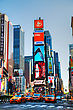 "NEW YORK CITY - MAY 12: Times Square With Tourists On May 12, 2013. Iconified As ""The Crossroads Of The World"" It's The Brightly Illuminated Hub Of The Broadway Theater District, One Of The World's Bu"