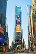 """NEW YORK CITY - MAY 12: Times Square With People On May 12, 2013. Iconified As """"The Crossroads Of The World"""" It's The Brightly Illuminated Hub Of The Broadway Theater District, One Of The World's Busi"""
