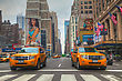 NEW YORK CITY - MAY 12: Yellow Taxis At The Street On May 12, 2013 In New York. Yellow Cars Serve As Taxis In NYC And Are Easy To Spot Among Other Vehicles Because Of Their Color stock photography