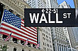 New York Stock Exchange With American Flags And Wall Street Sign In Front stock photo