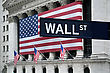 New York Stock Exchange With American Flags And Wall Street Sign In Front stock image