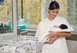 Newborn and Nurse stock image