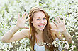 Nice Young Blond Lady Showing Her Hands And Smiling stock photo