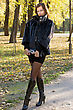 Nice Young Woman Walking In Autumn Park