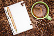 Notebook, Pen And Cup Of Coffee On Wood Table stock photo