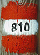 Numbers 810 Painted On Wooden Post stock photography