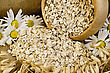 Oat Flakes In A Wooden Bowl, Stalks Of Oats, Chamomile On Sackcloth And Wooden Board