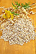 Oat Flakes With Yellow Wildflowers The Tansy And Stalks Of Oats On A Wooden Board stock photography