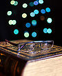 Old Book And Glasses On Bokeh Lights Background stock photography