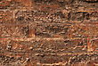 Stonemason Old Brick Brown Wall Is Closeup With Yellow Mould stock photo