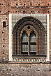Triangular Old Brown Castle Brick And Window In The Grass Of Castle Sforzesco Milan stock photo
