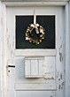 Old Door With Holiday Wreath stock photo