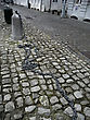 Old Downtown Street With Cobblestone And Big Long Chain On The Street. stock photography