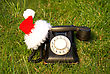 Old Fashioned Black Telephone With Santa's Hat stock photo